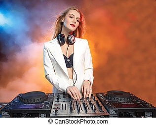 Beautiful blonde DJ girl on decks - the party,