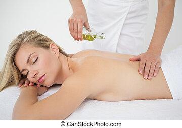 Beautiful blonde enjoying a back massage