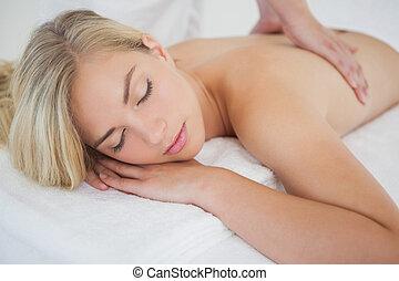 Beautiful blonde enjoying a massage