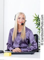 beautiful blonde, female customer service operator using headset