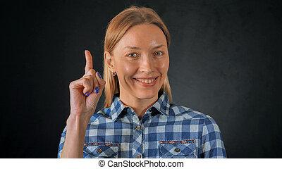 beautiful blonde female shows hand gesture eureka