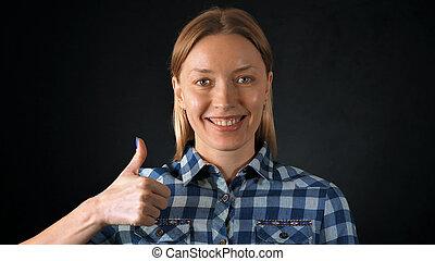 beautiful blonde female shows hand gesture like