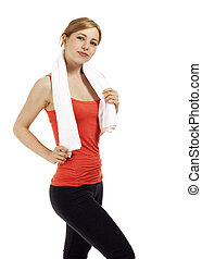 beautiful blonde fitness woman with a towel on white background