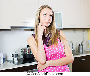 Beautiful blonde girl at kitchen