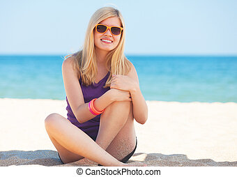 Beautiful blonde girl at the beach.