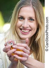 Beautiful Blonde Girl Holding Tea Cup