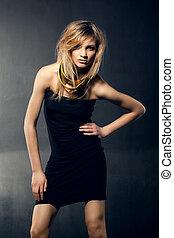 Beautiful blonde girl in a black dress