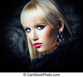 Beautiful blonde girl in luxury fur coat