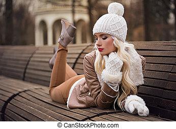 Beautiful blonde girl in posing outdoors