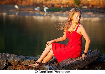 beautiful blonde girl in red dress