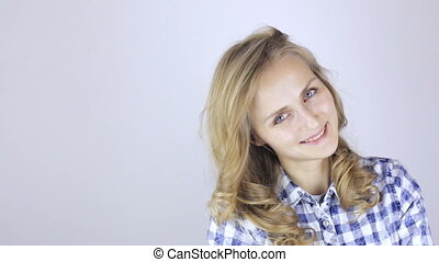Beautiful blonde girl looking at camera and smiling