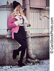 Beautiful blonde girl posing outdoors