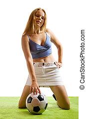 girl posing with football ball