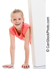 Beautiful blonde girl smiling looks out over the obstacles