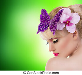 Beautiful blonde girl with orchid flower and butterfly