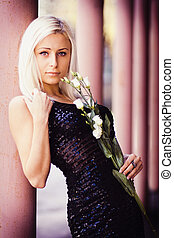 Beautiful blonde girl with white rose