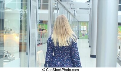Beautiful blonde goes to the store, Slow motion