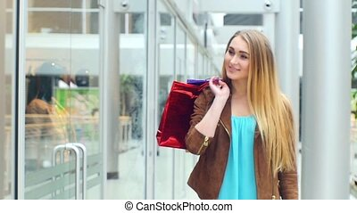 Beautiful blonde goes to the store shopping, Slow motion