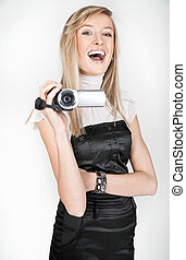 Beautiful blonde holding a videocamera