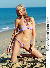 Beautiful blonde in purple bikini