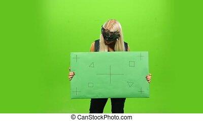 Beautiful blonde in venetian masquerade mask, New Year, green screen