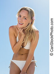 Beautiful blonde in white bikini sm