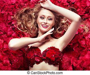 Beautiful blonde lady taking rose bath