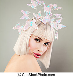 Beautiful Blonde Model Woman with Healthy Skin, Bob Hairstyle and Spring Flowers. Facial Treatment and Cosmetology