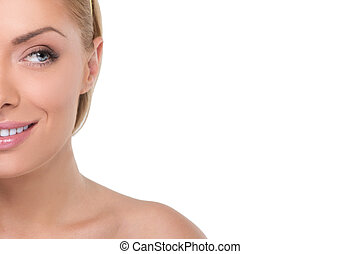Beautiful blonde. Portrait of beautiful blond hair women with make-up looking away and smiling while isolated on white