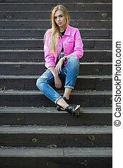 Beautiful blonde posing outdoors.