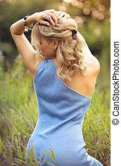 Beautiful blonde shows graceful back