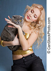 Beautiful blonde smiling woman with grey cat