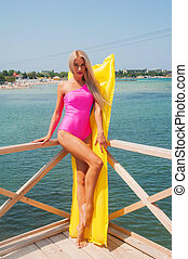 Beautiful blonde sunbathing in the sun