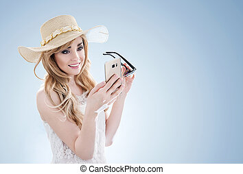 Beautiful blonde using a cell phone