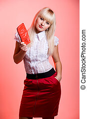 Beautiful blonde with a red purse