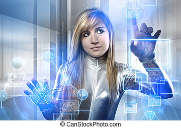 beautiful blonde with silver latex jumpsuit with digital tablet