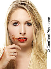 beautiful blonde woman after eating chocolate on white background