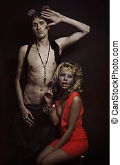 beautiful blonde woman and a man with ears mouse