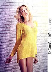 Beautiful blonde woman .
