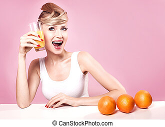 Beautiful blonde woman drinking juice.