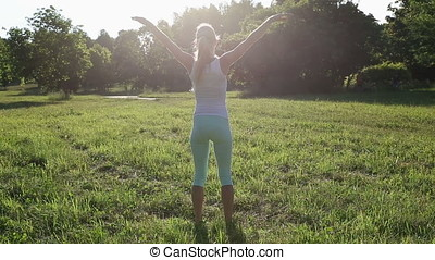 Beautiful blonde woman engaged in fitness in the park