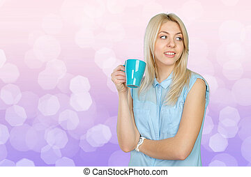 Beautiful blonde woman holding a cup of coffee