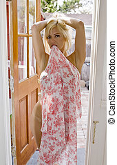 Blonde Woman holding a Sarong in Her Teeth