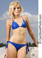 beautiful blonde woman in blue bikini