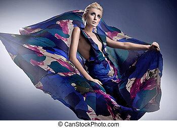 Beautiful blonde woman in georgeus dress