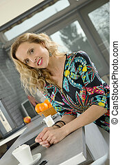 beautiful blonde woman in her kitchen