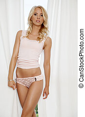beautiful blonde woman in pink lingerie