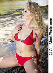 beautiful blonde woman in red bikini
