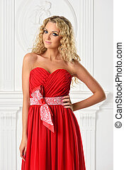 beautiful  blonde  woman in red dress.