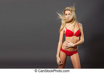 Beautiful blonde woman in red lingerie